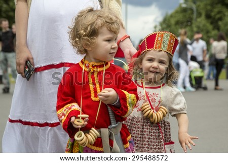MOSCOW,RUSSIA - JULY 11: Participants of a Baby Stroller Parade in Gorky Park during the celebration of the Day of Family, Love and Fidelity on 11 of July 2015 in Moscow, Russia - stock photo
