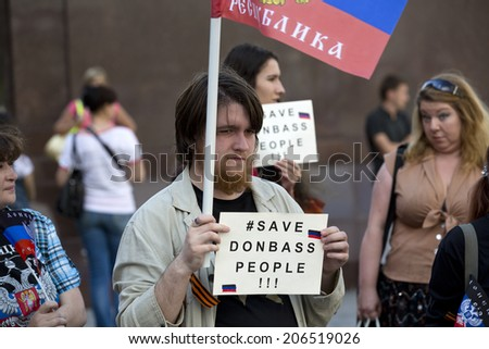 MOSCOW, RUSSIA - JULY 06: People ask President Putin to send troops to Eastern Ukraine at unauthorized rally near Red Square on 6th of July 2014 in Moscow, Russia - stock photo