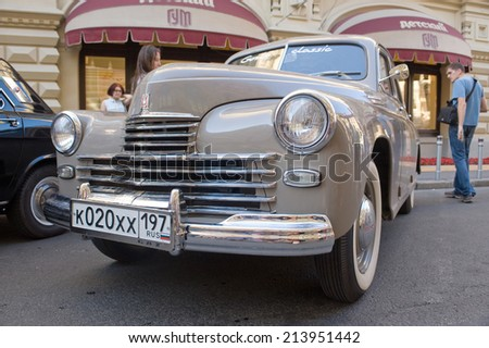 "MOSCOW, RUSSIA - July 26, 2014: Soviet retro car GAZ-M20 ""Pobeda"" retro rally Gorkyclassic in the Parking lot near Gum Department store, Moscow, front view"