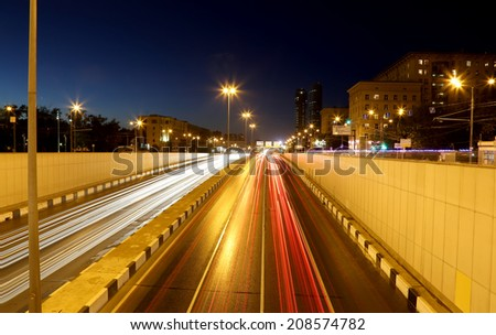 MOSCOW, RUSSIA- JULY 19, 2014:Traffic on the highway of big city (at night), Moscow, Russia
