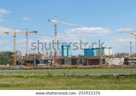 "MOSCOW, RUSSIA - July 1, 2012: Tushino airfield in the summer, the views of the cranes on the construction of the stadium ""Spartak"""