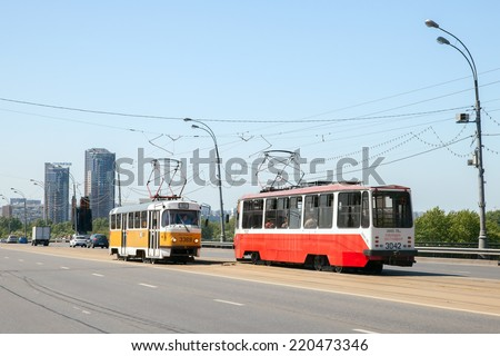 MOSCOW, RUSSIA - JULY 16, 2014: Two trams on Stroginskoye highway in sunny summer day - stock photo