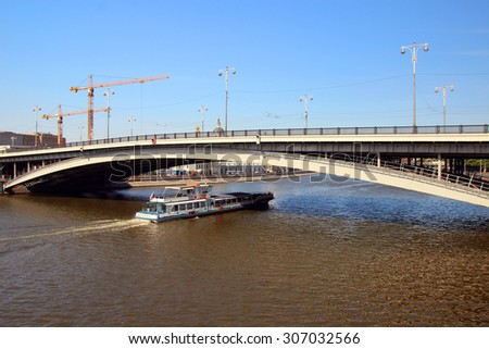 Moscow, Russia, July 5, 2015, View Ustyinsky Bridge and pleasure boat.