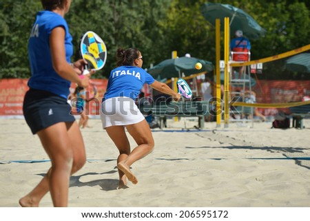 MOSCOW, RUSSIA - JULY 19, 2014: Woman double of Italy in the match against Russia during ITF Beach Tennis World Team Championship. Italy won in two sets - stock photo