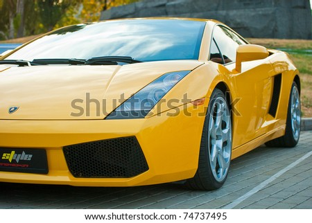 MOSCOW, RUSSIA-JULY 31: Yellow Lamborghini in exhibition parking at an annual event, the VI race of vintage cars 'Night Moscow Classic Rally'. July 31, 2010 in Moscow, Russia - stock photo