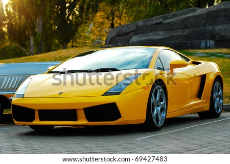 MOSCOW,RUSSIA-JULY 31: Yellow Lamborghini in exhibition parking show of retro-cars 'Night Moscow Classic Rally-2010' on July 31, 2010 in Moscow, Russia - stock photo
