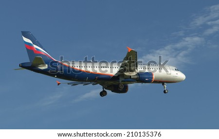 Moscow, Russia - June 17, 2012: Airliner calling on landing at the airport in the evening