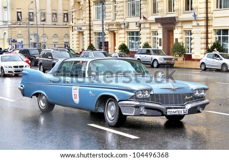 MOSCOW, RUSSIA - JUNE 3: American motor car Chrysler Imperial competes at the annual L.U.C. Chopard Classic Weekend Rally on June 3, 2012 in Moscow, Russia.