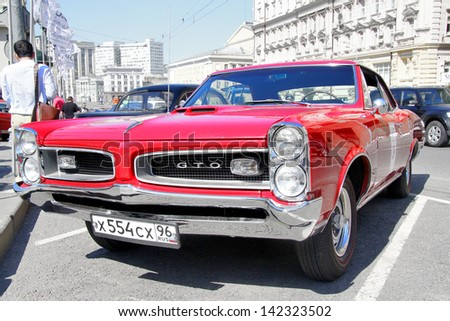 MOSCOW, RUSSIA - JUNE 2: American muscle car Pontiac GTO competes at the annual L.U.C. Chopard Classic Weekend Rally on June 2, 2013 in Moscow, Russia. - stock photo