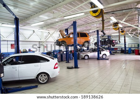 MOSCOW. RUSSIA - JUNE 12, 2013: Cars for repair service station. Auto Service is the official dealer of Auto VAZ - stock photo