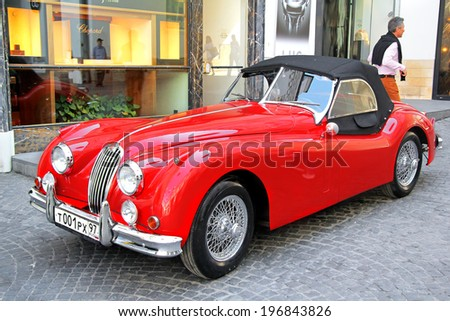 MOSCOW, RUSSIA - JUNE 2, 2013: English motor car Jaguar XK150 competes at the annual L.U.C. Chopard Classic Weekend Rally. - stock photo