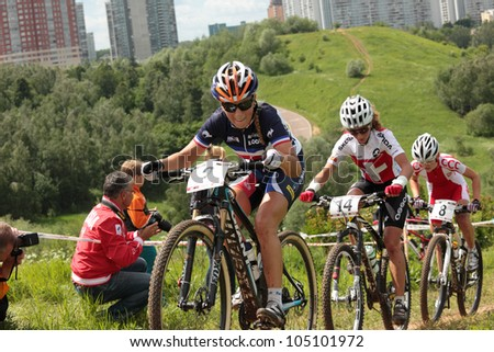 MOSCOW, RUSSIA - JUNE 9: French Pauline Ferrand Prevot followed by Swiss Jolanda Neff and Pole Paula Gorycka in the European Mountain Bike Cross-Country Championship in Moscow, Russia at June 9, 2012