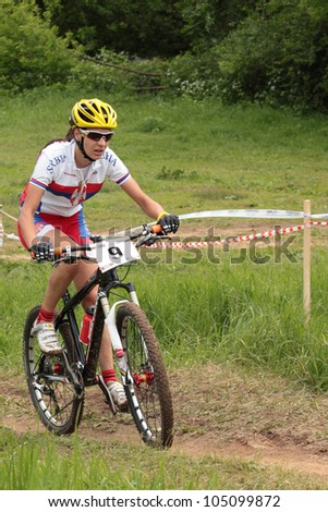 MOSCOW, RUSSIA - JUNE 9: Jovana Crnogorac (Serbia) races during the European Mountain Bike Cross-Country Championship in Moscow, Russia at June 9, 2012