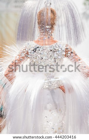 MOSCOW, RUSSIA - JUNE 27, 2016:  Model walk runway for Valentin Yudashkin show from the collections of different years. Evening of Charity Fund Russian Silhouette. Art Gallery of Zurab Tsereteli