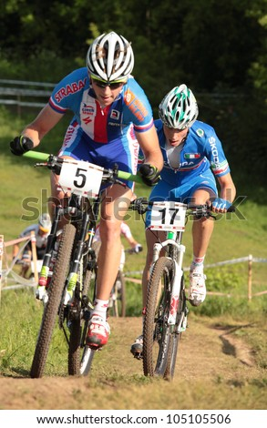 MOSCOW, RUSSIA - JUNE 9: Ondrej Cink (Czech Republic, left) and Luca Braidot (Italy) in the European Mountain Bike Cross-Country Championship in Moscow, Russia at June 9, 2012