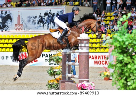 MOSCOW, RUSSIA-JUNE 26: rider Safronov Mikhail(RUS) at the Hanover horse Kazhu in stage of the International event CSI4*RR/ Russian Championship Show Jumping on June 26, 2011 in Moscow, Russia