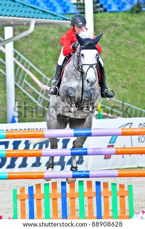 MOSCOW, RUSSIA - JUNE 26:Rider Simony Natalia(RUS) with a Holsten horse Solana13 participates at the International event CSI4*RR/ Russian Championship Show Jumping on June 26, 2011 in Moscow, Russia