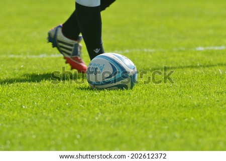MOSCOW, RUSSIA - JUNE 29, 2014: Rugby ball on the grass during the FIRA-AER European Grand Prix Series. England won the tournament