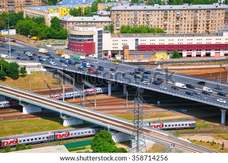 MOSCOW, RUSSIA - JUNE 9, 2014: Third Ring Road, vehicles traveling on the highway. Movement of trains on the railway, Russian Railways (RZD) - stock photo