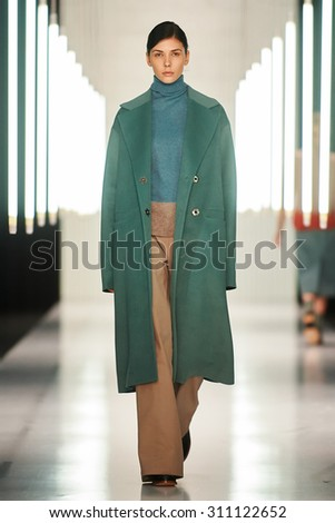 Moscow, Russia -  29 March 2015: A model walks on the Julia Nikolaeva catwalk for FALL 2015 during the MERCEDES-BENZ FASHION WEEK RUSSIA.  - stock photo