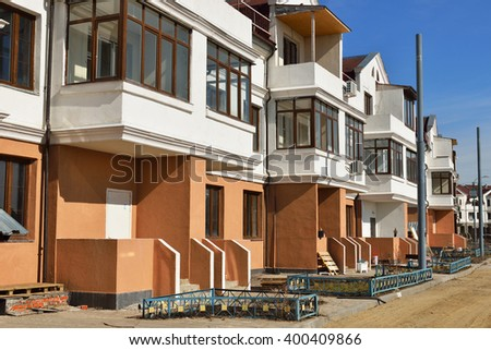 MOSCOW, RUSSIA - MARCH 29, 2016: Construction of new apartment houses in Moscow. Under construction townhouses - stock photo
