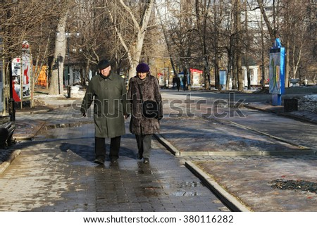 MOSCOW, RUSSIA - MARCH 11, 2015:Elderly couple walking in Catherine Park on a sunny day