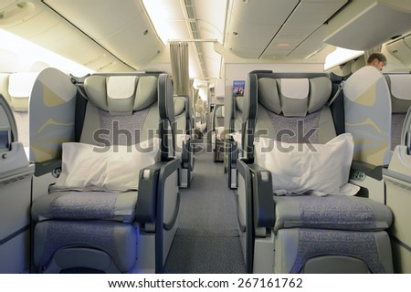 MOSCOW, RUSSIA - MARCH 30, 2015: Emirates first class Boeing-777 interior. Emirates is one of two flag carriers of the United Arab Emirates along with Etihad Airways and is based in Dubai. - stock photo