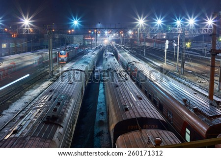 MOSCOW, RUSSIA - MARCH 05: Passenger and Post wagons on backside railways of Moscow railway station (Kazanskyj vokzal) at evening time on March 05, 2015 in Moscow, Russia.