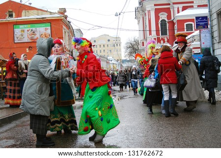 MOSCOW, RUSSIA - MARCH 16: People dancing on the street. Shrovetide celebration in Moscow city center. Taken on March 16, 2013 in Moscow, Russia.