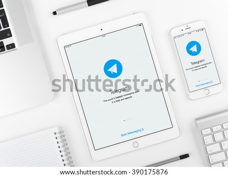 Moscow, Russia - March 12, 2016: Telegram application on iPad and iPhone display. Telegram is a cloud-based instant messaging service - stock photo