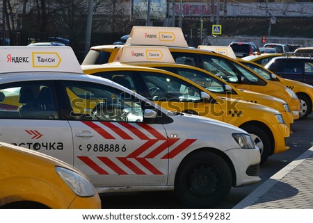 Moscow, Russia - March 14, 2016. Yandex taxis standing in a row