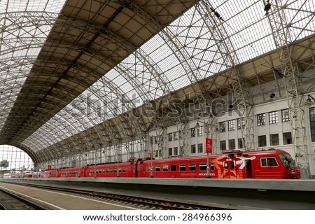 MOSCOW, RUSSIA - MAY, 14 2015: Aeroexpress red Train on Kiyevskaya railway station  (Kiyevsky railway terminal,  Kievskiy vokzal) -- is one of the nine main railway stations of Moscow, Russia   - stock photo
