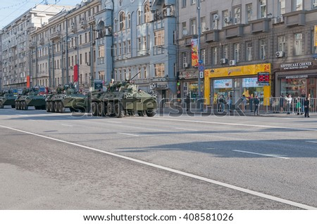 MOSCOW/RUSSIA - MAY 9: BTR-82 8x8 wheeled amphibious armored personnel carriers (APC) motorcade moves on parade devoted to Victory Day on May 9, 2013 in Moscow.