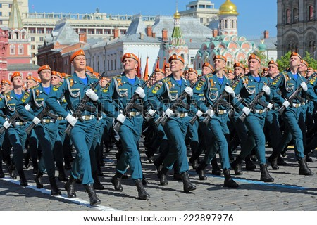 MOSCOW, RUSSIA - MAY 09, 2014: Celebration of the 69th anniversary of the Victory Day (WWII). Solemn marching of soldiers in Red Square. Cadets of the EMERCOM of Russia - stock photo