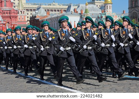 MOSCOW, RUSSIA - MAY 09, 2014: Celebration of the 69th anniversary of the Victory Day (WWII). Solemn marching of soldiers in Red Square. Cadets Moscow Institute of the Russian FSB border