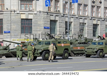 MOSCOW, RUSSIA - MAY 9, 2015: Celebration of the 70th anniversary of the Victory Day (WWII). Military equipment on Tverskaya street prepares to travel to the Red Square. The GAZ Tigr vehicle - stock photo