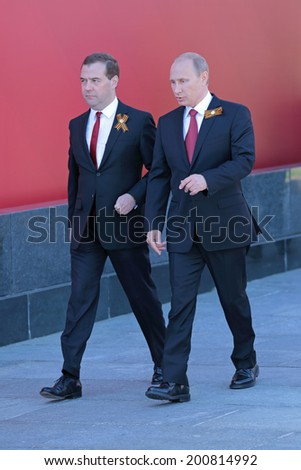MOSCOW, RUSSIA - MAY 09, 2014: Celebration of the 69th anniversary of the Victory Day (WWII) on Red Square. President Vladimir Putin and Prime Minister Dmitry Medvedev came to the ceremony
