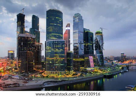 MOSCOW, RUSSIA - MAY 24, 2014: Cityscape of skyscrapers of Moscow City business complex and river. Moscow International Business Center Moscow City includes 20 futuristic buildings - stock photo