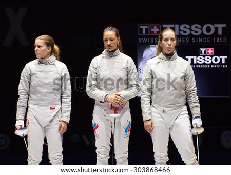 MOSCOW, RUSSIA - MAY 31 2015: E. Dyachenko, Y. Egorian and M. Zagunis just before finals on the World  fencing Grand Prix Moscow Saber in Luzhniki sport palace - stock photo
