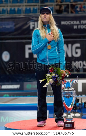 MOSCOW, RUSSIA - MAY 31 2015: Ekaterina Dyachenko sing a national anthem on World  fencing Grand Prix Moscow Saber in Luzhniki sport palace - stock photo