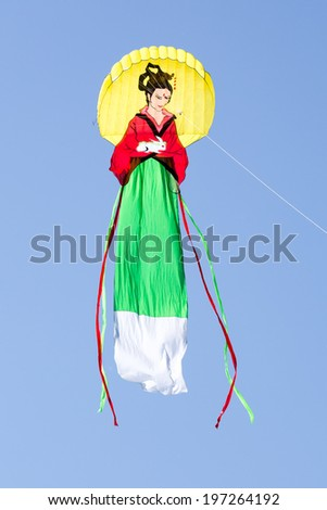 """MOSCOW, RUSSIA - MAY 31: Great japanese woman-like kite at the """"Harlequin sky"""" kites festival on MAY 31, 2014 in Moscow, Russia.  - stock photo"""