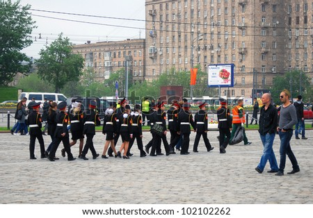 MOSCOW, RUSSIA -  MAY 09: Group of children in military uniform walking. Victory Day celebration on Poklonnaya Hill (Moscow) on May 09, 2012 in Moscow, Russia.