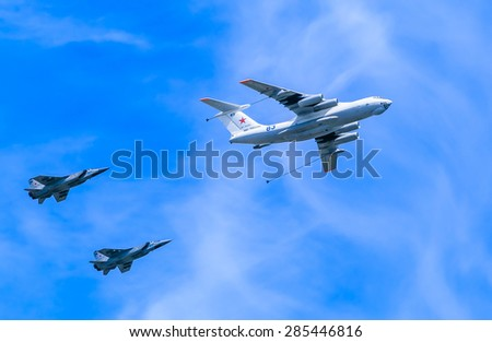 MOSCOW/RUSSIA - MAY 9: Il-78 (Midas) aerial tanker demonstrates refueling of 2 MiG-31 (Foxhound) supersonic interceptors on parade devoted to 70-th Victory Day aniversary on May 9, 2015 in Moscow.