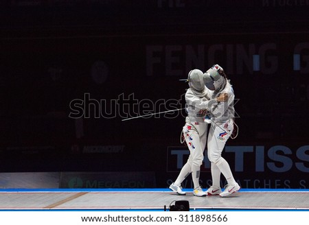 MOSCOW, RUSSIA - MAY 31 2015: Jung Kim and Sofia Velikaya hugging on the World  fencing Grand Prix Moscow Saber in Luzhniki sport palace - stock photo