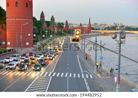 MOSCOW, RUSSIA - MAY 20, 2014:Kremlin Embankment is major street, located near Kremlin, in administrative district in central Moscow, running along Moskva River.