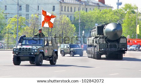 "MOSCOW, RUSSIA - MAY 6: Light multirole vehicle ""Rys"" and intercontinental ballistic missile Topol-M exhibited at the annual Victory day Parade dress rehearsal on May 6, 2012 in Moscow, Russia."