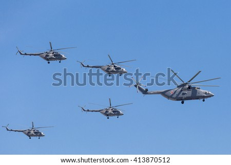 MOSCOW, RUSSIA - MAY 9: Mi-26 (Halo) and Mi-8AMTK (Hip) helicopters fly on military parade devoted to 70th anniversary of Victory Day in WWII in Europe aka The Great Patriotic War. - stock photo
