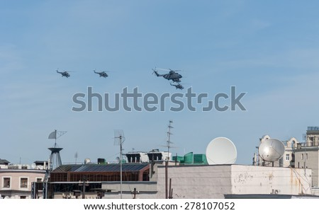 MOSCOW/RUSSIA - MAY 7: Mil Mi-26 (Halo) the largest and most powerful and 4 Mi-8AMTK (Hip) medium transport helicopters fly on parade devoted to 70-th Victory Day aniversary on May 7, 2015 in Moscow.
