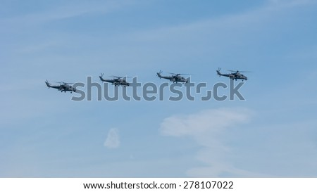 MOSCOW/RUSSIA - MAY 7: 4 Mil Mi-35M (flying tank, Stakan, Krokodil, Hind D) large gunship and attack helicopters and troop transport on parade devoted to Victory Day on May 7, 2015 in Moscow.