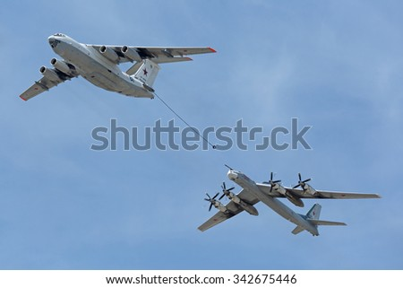 "MOSCOW, RUSSIA - MAY 9, 2015: Military parade of 70th anniversaries of a victory day. Flight of aircraft over the city. The tanker Ilyushin Il-78 and strategic bomber and missile platform Tu-95 ""Bear"""